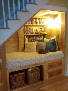 Reading Nook Under StairsYou can find Reading nooks and more on our website.Reading Nook Under Stairs Under Stairs Nook, Kitchen Under Stairs, Under Staircase Ideas, Under Stairs Playhouse, Under Basement Stairs, Basement Ideas, Living Room Under Stairs, Small Basement Design, Basement Staircase