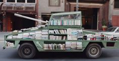 free-book-tank-library-weapon-of-mass-instruction-raul-lemesoff-9 an eccentric artist in Buenos Aires, Argentina, has created a bizarre tank-like 'Weapon Of Mass Instruction'.  delivers books