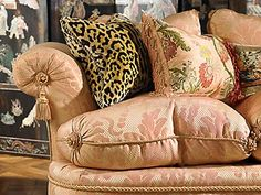 The touch of leopard looks great against this very elegant sofa done in pink.