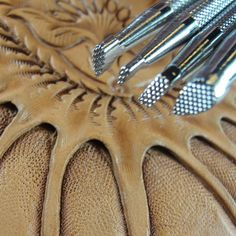 Background leather stamping tools to make a striking impression in your work. Includes checkered, pebble and other matting background designs. Leather Working Tools, Leather Craft Tools, Metal Working, Leather Crafts, Leather Projects, Metal Crafts, Leather Carving, Leather Tooling, Checker Background