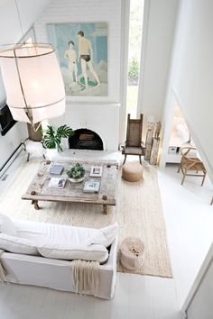 For designers Josh Kay and Susana Simonpietri, a 1973 house in East Hampton, N., offers an escape from Brooklyn. Gorgeous all white and neutral living room decor with bold colorful artwork above the white fireplace. Living Room Designs, Living Room Decor, Living Spaces, Hamptons Living Room, Hamptons Decor, The Hamptons, Style At Home, The Design Files, Home Fashion