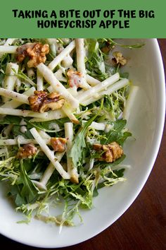 Ingredients: • 2 heads frisee, chopped into bite-size pieces • 4 cups wild arugula • 1 cup candied walnuts • 2 large Honeycrisp apples, sliced into thin matchsticks • Spiced Cider Vinaigrette (recipe below)