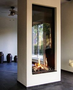 double-sided fireplace - see-through fireplace - modern fireplace - Best Los Angeles Interior Designer - Atlanta Interior Designer - interior design ideas - fireplace design ideas - home decor - living room decor - home accessories - how to decorate House, Interior, Home Fireplace, Fireplace Design, Freestanding Fireplace, House Interior, Indoor Fireplace, Modern Fireplace, Living Area Design