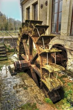 water wheel in old mill in Guérigny, Nièvre, France