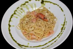 Our Shrimp Spaghetti - shrimps tossed in a garlic oil infused spaghetti Shrimp Spaghetti, Garlic Oil, Tossed, Pasta Dishes, Ethnic Recipes, Food, Essen, Meals, Yemek