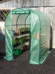 This steel-frame hothouse/greenhouse features shelving for ALL your seed trays PLUS has additional floor space for gardening tools and supplies. Greenhouse Growing, Small Greenhouse, Greenhouse Gardening, Greenhouse Ideas, Gardening Books, Greenhouse Shelves, Portable Greenhouse, Backyard Greenhouse, Vegetable Gardening