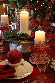 Candy canes adorn glowing candles for a fun and youthful tablescape.