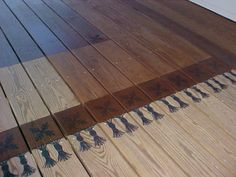 Jen hand painted/stained the rug on this Deck