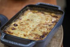 Chef Michael White has perfected potato gratin using two types of cheese, thyme, and nutmeg.