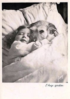 child in bed with dog vintage photo