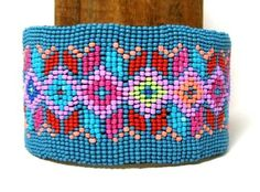 Adjustable cuff bracelet with smooth leather backing. Sharp geometric design.  $16.95  Free shipping within the USA  #bracelet #beadwork #beaded #regalia