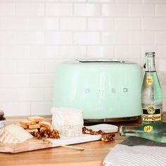 Based in Italy, Smeg is known for its retro and durable kitchen appliances. Featuring an energy-efficient design, this 2 Slice Toaster is both fun to use and easy on the eyes. Green Toaster, Smeg Toaster, Kitchen Dining, Kitchen Decor, Kitchen Stuff, Kitchen Ideas, Grilled Cheese In Toaster, Domestic Appliances, Green Cushions