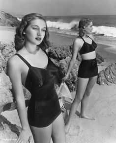 Model/actress Georgia Lange (left), one of the 'Goldwyn Girls,' wears a one-piece black satin latex bathing suit and other model in a two-piece suit poses behind her, Retro Mode, Mode Vintage, Vintage Girls, Vintage Outfits, Vintage Dress, Vintage Clothing, Vintage Bathing Suits, Vintage Swimsuits, 1940s Fashion