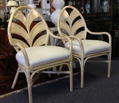 Pair of Rattan Chairs with Palm Shield Backs. Light, tropical seating for your living room, family room or breakfast table. Cream finish, white cushions. 23 x 23 x 39 inches tall. SOLD