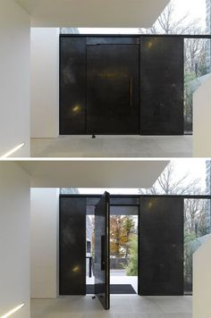 This large pivoting black steel door definitely makes a statement.