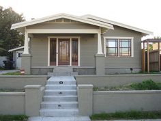Bungalow painted with Sherwin-Williams' Bunglehouse Grey, Roycroft Vellum, and Aurora Brown
