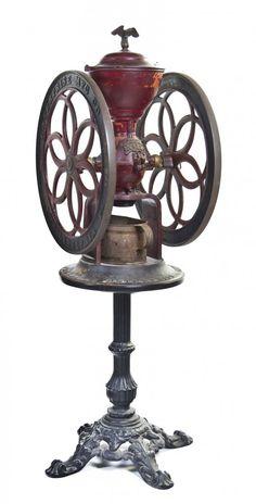 An American Cast Iron Coffee Grinder,  marked Enterprise Mfg. Co., No. 12. Philadelphia, PA, retaining the original stand