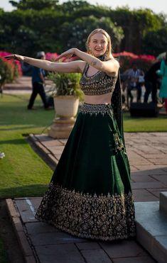 Sophie Turner Turns Up The Heat As She Shows Her Spectacular Moves At Priyanka Nick's Sangeet - HungryBoo Indian Bridal Outfits, Indian Fashion Dresses, Dress Indian Style, Indian Designer Outfits, Bridal Dresses, Red Lehenga, Lehenga Choli, Sari, Floral Lehenga