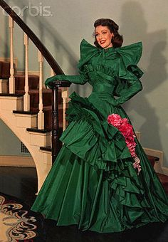 https://flic.kr/p/a8oRh4 | TAFFETA-342 | Actress Loretta Young takes your breath away standing covered from chin to toes in ravishing green taffeta by Adrian. It's the dress she wore to receive the 1947 Oscar.  Photo # TAFFETA-368 shows it with the capelet removed.  Would that it were I. Image by © CORBIS