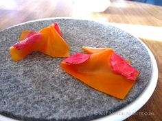 From Rene Redzepi's Noma: Sea-buckthorn 'leather' with pickled rose hip petals