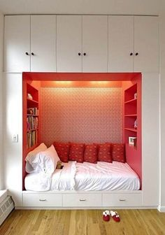 Bedroom. Alluring  Small Bedroom Design Layout Performing White Solid Wooden Cupboard With Cozy Bed Feels And Red Accent Wall Inside Featuring Built In Shelves In Two Side Along With Laminate Wooden Floor Surface For Design A Small Bedroom Ideas. Upgrade Your Small Space With Breathtaking Design A Small Bedroom Ideas