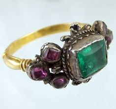 Seventeenth century silver and gold ring with emerald and rubies