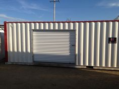 Rollup doors installed on side of 20' shipping container with custom paint to match the storage facility.