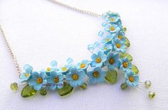 "Forget me not necklace This necklace features hand sculpted light blue (aqua) flowers ""Forget-me-nots"", which are decorated with yellow seed beads"