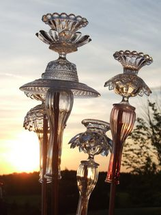 Glass garden ornaments with old plate and vases