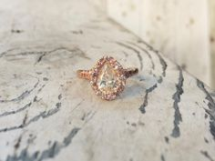 pear shaped white diamond set in 18k rose gold + paved pink diamonds and sapphires by Jessica Seaton