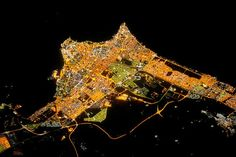 Space Pictures  Night photos can sometimes reveal more than those taken during the day. This nighttime portrait of Kuwait City, released recently by NASA's Earth Observatory, shows the pace of development in the Persian Gulf metropolis.