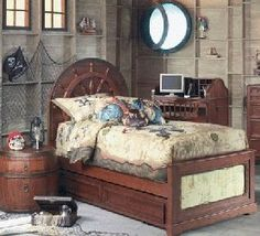 Boys bedroom - Pirate ship theme. The bedding is the treasure map, how cute is that.
