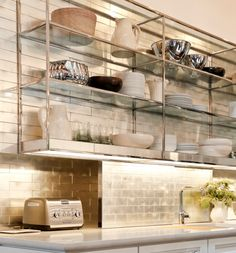 I love the industrial chic stainless shelves... kind of like a trendy restaurant kitchen has moved into your house!