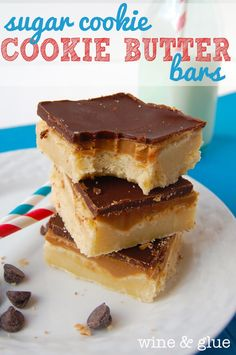Sugar Cookie Cookie Butter Bars- The soft chewiness of this sugar cookie recipe combined with the rich amazing taste of the cookie butter and the smooth chocolate make this a rich and decadent dessert that comes together easily! via Wine & Glue