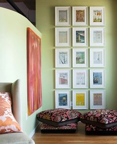 I've recommended this type of application many times over; this is just another perfect example of an amazing design concept (this one, especially beautiful) of displaying artwork en masse by unifying w/framing & matting.