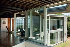 Ample glazing, coupled with voids in the roof plane, allows for natural light and solar gain. Infrared panels in the ceiling are an unobtrusive mechanical heating device. Residential Architecture, House Architecture, Mexican Hacienda, Tree Felling, New Zealand Houses, Cedar Homes, Old Oak Tree, Glass Front Door
