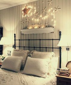 Starfish with Christmas Lights over Bed: http://beachblissliving.com/above-bed-decor-shelf-ideas-art-more/
