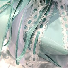slender ribbon threaded through lace; ribbon and lace from May Arts