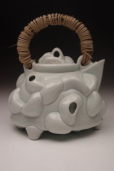 Porcelain & celadon glazed modern teapot.