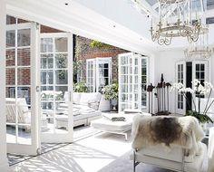 Indoor/Outdoor Living...Love these doors that open up....