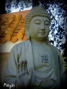 Swastika symbol (non-Nazi) on ancient cultural artifacts, here Buddha statue
