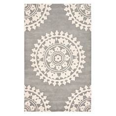 Pairing an oversized medallion motif with a soft light grey and ivory palette, this elegant wool rug is hand-tufted in India for artful appeal. $415 8'X11'