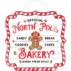 Cozy up your kitchen with a North Pole Bakery Easel Sign! The fiberboard sign features the headline 'Official North Pole Bakery' with a gingerbread man in the center and a candy cane border. Gingerbread House Kits, Christmas Gingerbread, Gingerbread Crafts, Christmas Ships, Christmas Vinyl, Father Christmas, Christmas Quotes, Disney Christmas, Christmas Baby
