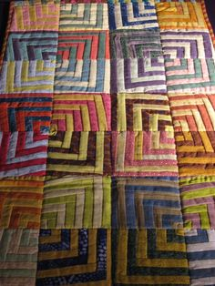 Kaffe Fassett - Quilt  I love quilts where the lines don't meet up on purpose.