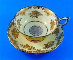 Gold Design with Yolk Yellow Exterior Paragon Tea Cup and Saucer Set