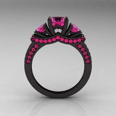 black ring with pink diamonds