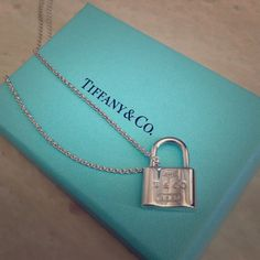 Small Tiffany lock pendant necklace Authentic Tiffany small silver padlock charm with chain. New with blue box and blue felt bag. New, never worn. It was a gift, so I don't have tags. Tiffany & Co. Jewelry Necklaces