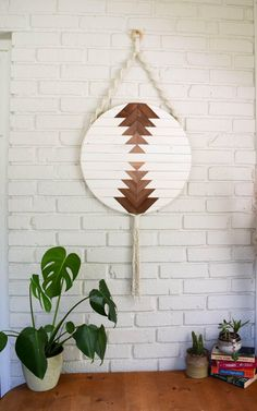 These round macrame and wood wall art hangings are bordered with natural cotton rope and incorporate bohemian macrame accents for a relaxed piece of unique artwork. A natural wood ring is installed at the top for easy installation in your favorite space. Diy Wood Wall, Metal Tree Wall Art, Wooden Wall Art, Hanging Wall Art, Diy Wall Art, Wooden Walls, Wood Art, Wall Decor, Unique Wall Art