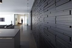 Love the textured wall by Pitsou Kedem - Architect....this for the fireplace