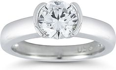 Half Bezel Solitaire Diamond Engagement Ring  : This diamond engagement ring is a traditional solitaire setting with a half bezel setting around the center stone of your choice which gives a modern twist on a classic style.